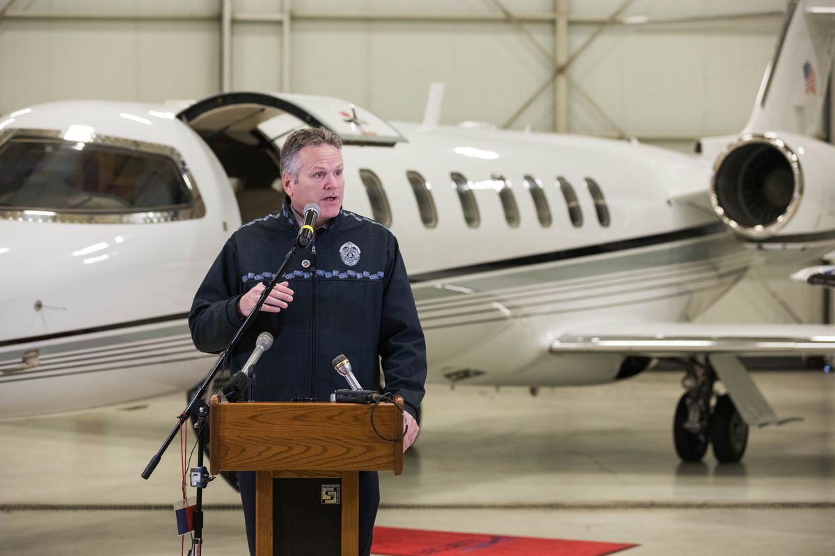 Gov.-elect Mike Dunleavy announces new members of his transition team Friday, Nov. 9, 2018 at Security Aviation. Behind Mr. Dunleavy is a Lear 45 charter jet, owned by Security Aviation. (Loren Holmes / ADN)