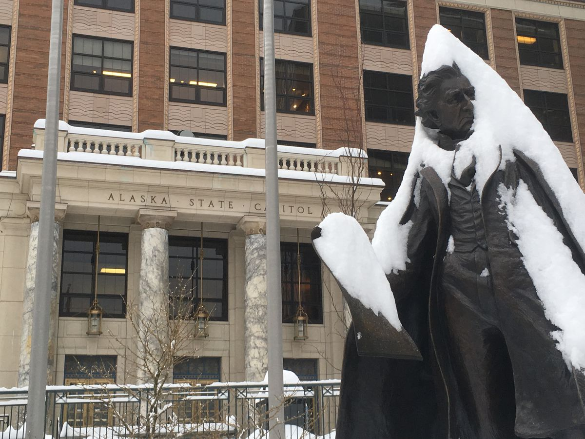 The snow-covered statue of William Seward is seen in front of the Alaska State Capitol on Friday. As lawmakers published their second collection of pre-filed bills, more than a foot of snow blanketed the capital city. (James Brooks / ADN)