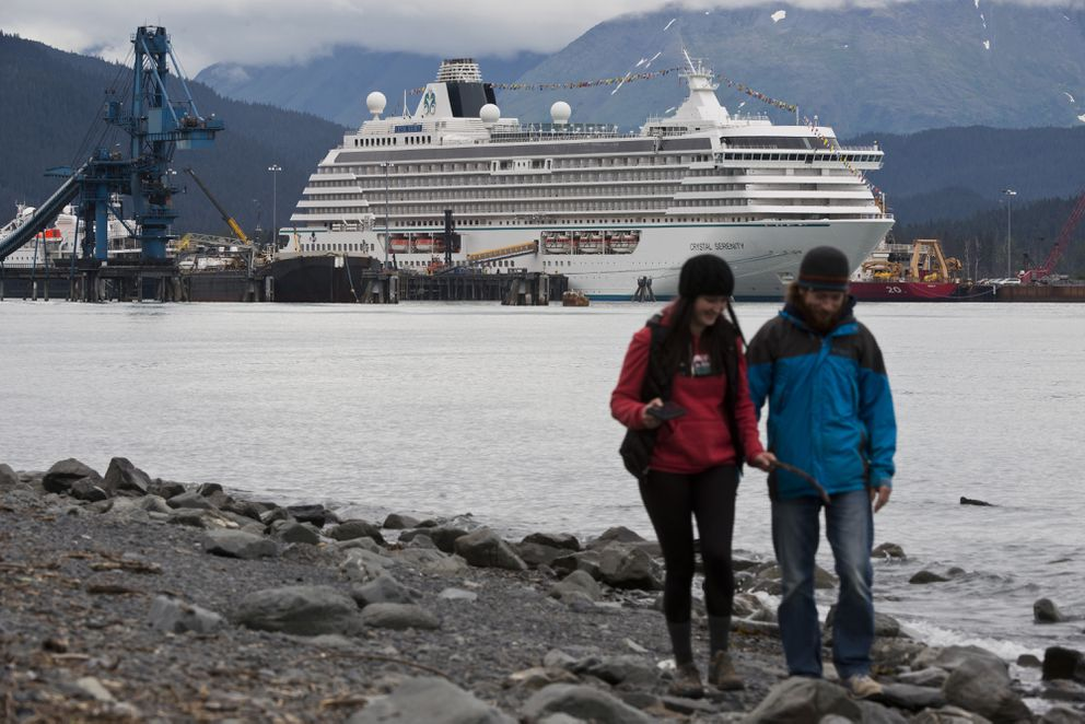 Shawna Nelson, left, and Chad Kaina walk the Resurrection Bay shoreline in Seward. The luxury cruise liner Crystal Serenity is docked in the distance. The Crystal Cruises vessel will travel north through the Bering Strait and along the Arctic coast of Alaska and Canada before reaching the Atlantic Ocean. Marc Lester / Alaska Dispatch News)