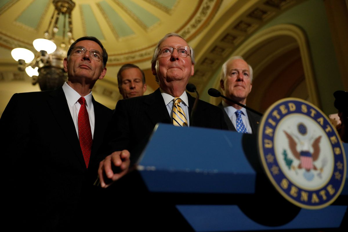 Senate Majority Leader Mitch McConnell, accompanied by Sen. John Cornyn, R-Texas, and Sen. John Barrasso, R-Wyo., speaks with reporters following the successful vote to open debate on a health care bill on Capitol Hill in Washington, D.C.,on Tuesday. REUTERS / Aaron P. Bernstein