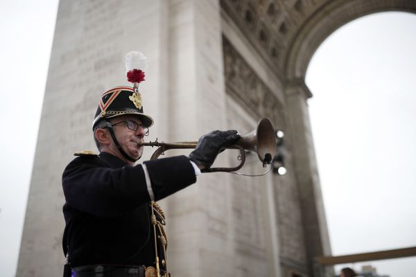 A Republican Guard blows a bugle that signaled the Armistice in 1918 before a commemoration ceremony for Armistice Day, 100 years after the end of the First World War at the Arc de Triomphe in Paris, Sunday, Nov. 11, 2018. (Benoit Tessier/Pool Photo via AP)