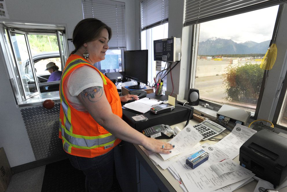 Melisa Bannon filled out receipts by hand in the Mat-Su Central Landfill scale house on Monday, as a result of the cyber attack on the computer system. Starting Wednesday the landfill will be open 8 a.m. to 5 p.m. seven days a week and will be closed to commercial traffic on Sunday. (Bill Roth / ADN)