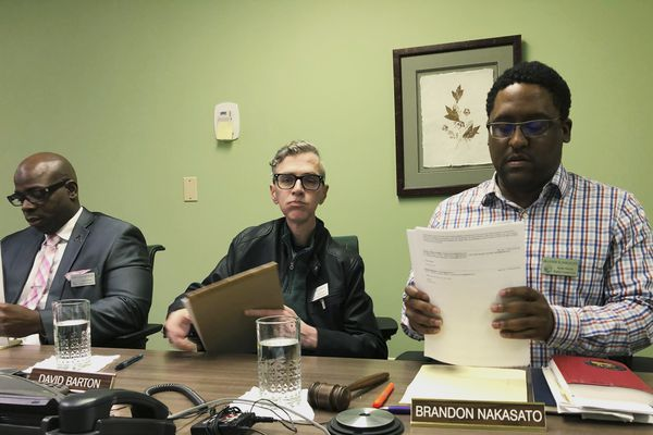 Alaska Human Rights Commission members Marcus Sanders, left, David Barton, middle, and chairman Brandon Nakasato are shown at the conclusion of a commission meeting Monday, April 1, 2019, in Anchorage, Alaska. The commission went into executive session for nearly three hours but recessed when it could not come to a conclusion on the fate of Marti Buscaglia, its executive director after Alaska Gov. Mike Dunleavy requested an investigation following her social media complaint about a pickup parked in the commission's lot that had a
