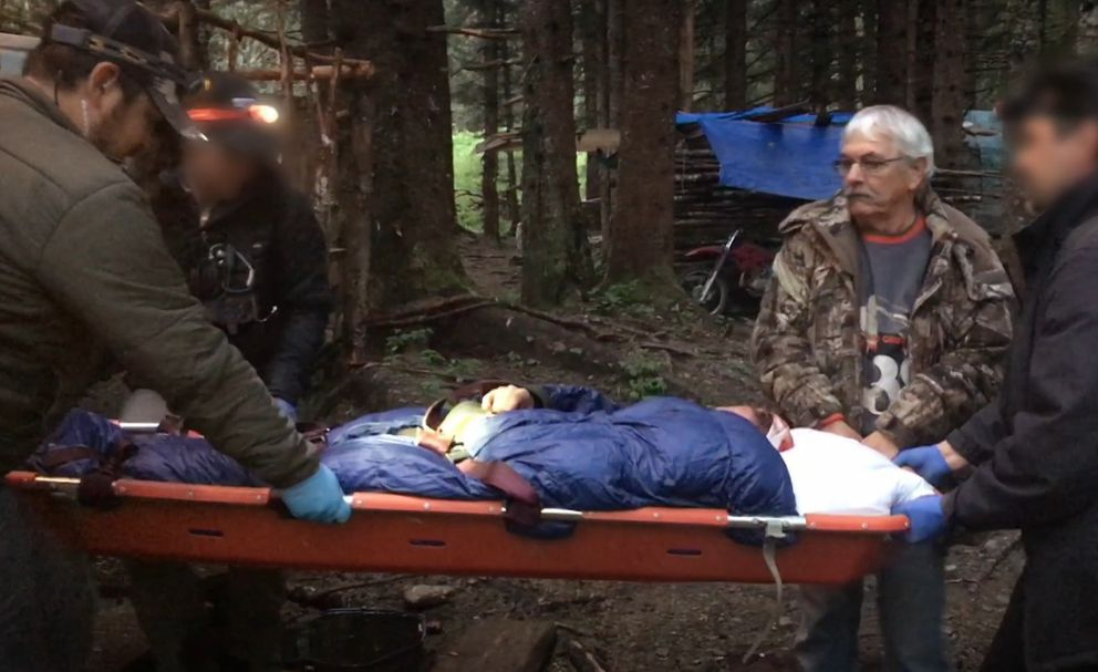 "Matt Brown is carried in a stretcher after apparently suffering a head injury on an episode of ""Alaskan Bush People."" (Screen capture via Discovery.com)"