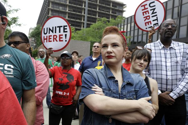 In this Wednesday June 27, 2018 file photo, Amanda Hammock, center, a Delaware County, Pa. Democratic party activist, is dressed as Rosie the Riveter as she attends a protest by Philadelphia Council AFL-CIO in Philadelphia. The protesters denounced Wednesday's U.S. Supreme Court ruling that government workers can't be forced to contribute to labor unions that represent them in collective bargaining, dealing a serious financial blow to organized labor. (AP Photo/Jacqueline Larma)