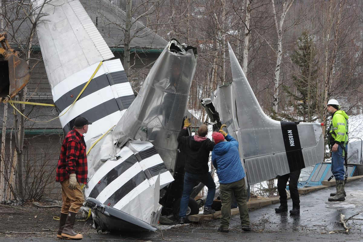 On Sunday workers removed a Cessna 185 wheel-ski equipped airplane that crashed while landing at Fire Lake on Saturday evening, April 11, 2020. Four people were injured in the crash. (Bill Roth / ADN)