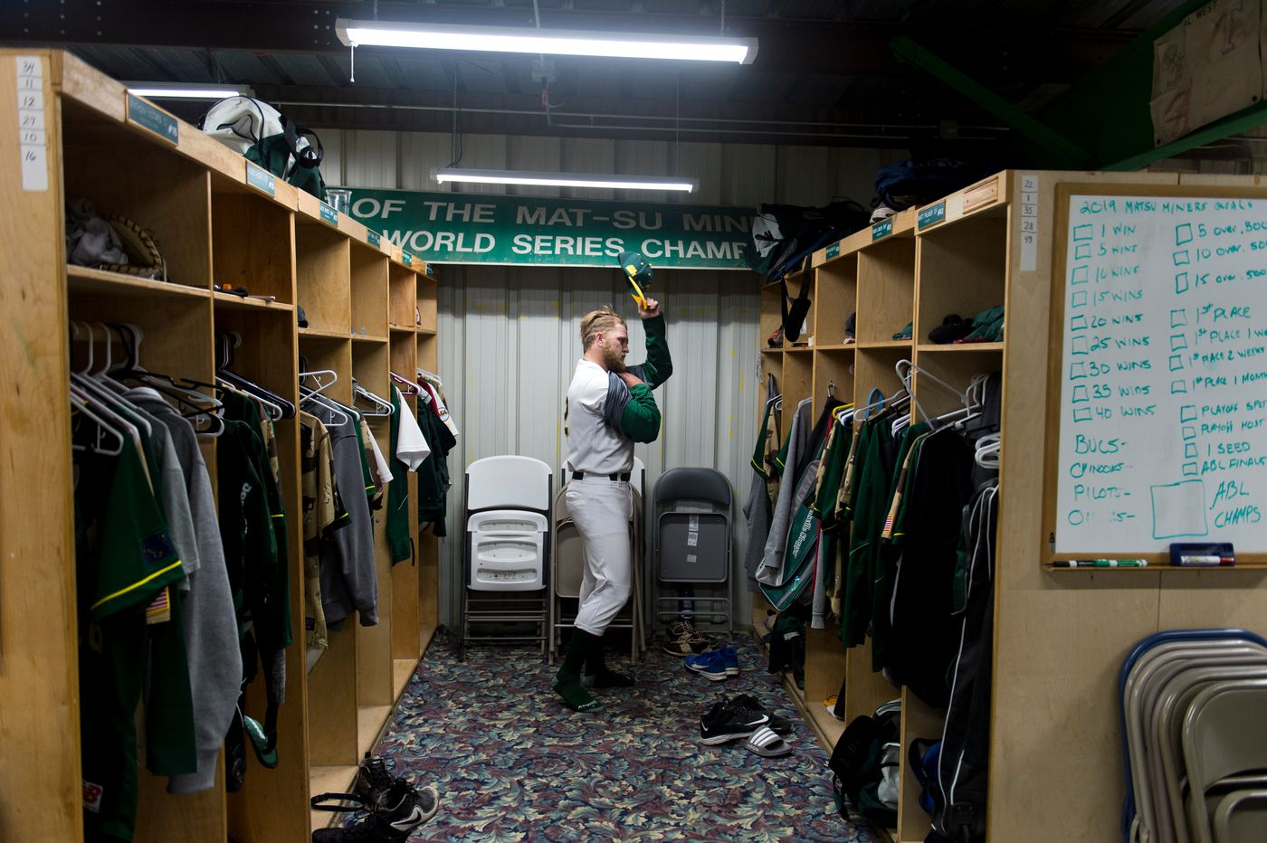 Miners pitcher Evan Floyd suits up before the first game Wednesday in Palmer. (Marc Lester / ADN)