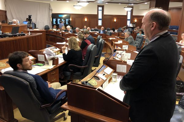 Rep. Zack Fields, D-Anchorage, listens as Rep. Gary Knopp, R-Soldotna, speaks against a capital budget amendment that would have paid a $3,000 Permanent Fund dividend. The amendment failed 15-21. (James Brooks / ADN)
