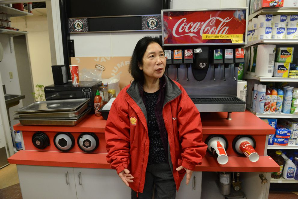 Insook Baik, owner of the Mountain View Shell station, talks about the free Thanksgiving lunch on Wednesday. (Bob Hallinen / ADN)