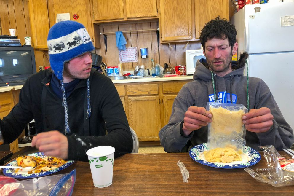 Nicolas Petit, right, talks with Joar Leifseth Ulsom at the White Mountain checkpoint on Tuesday. (Loren Holmes / ADN)