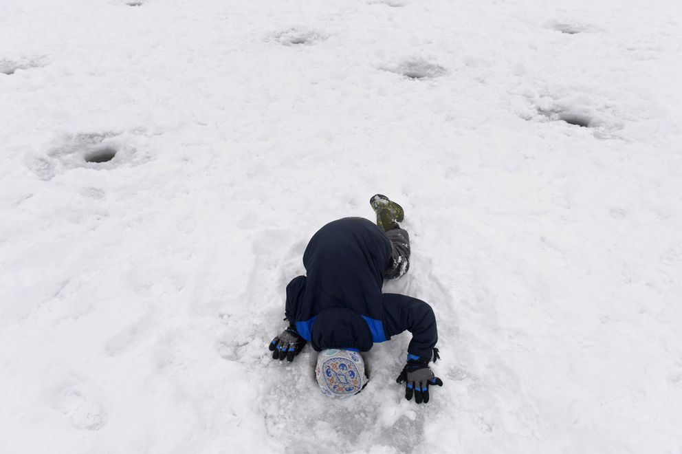 Susitna Elementary School's Cotter Sheldon, 8, gets a close look into the water. (Marc Lester / ADN)
