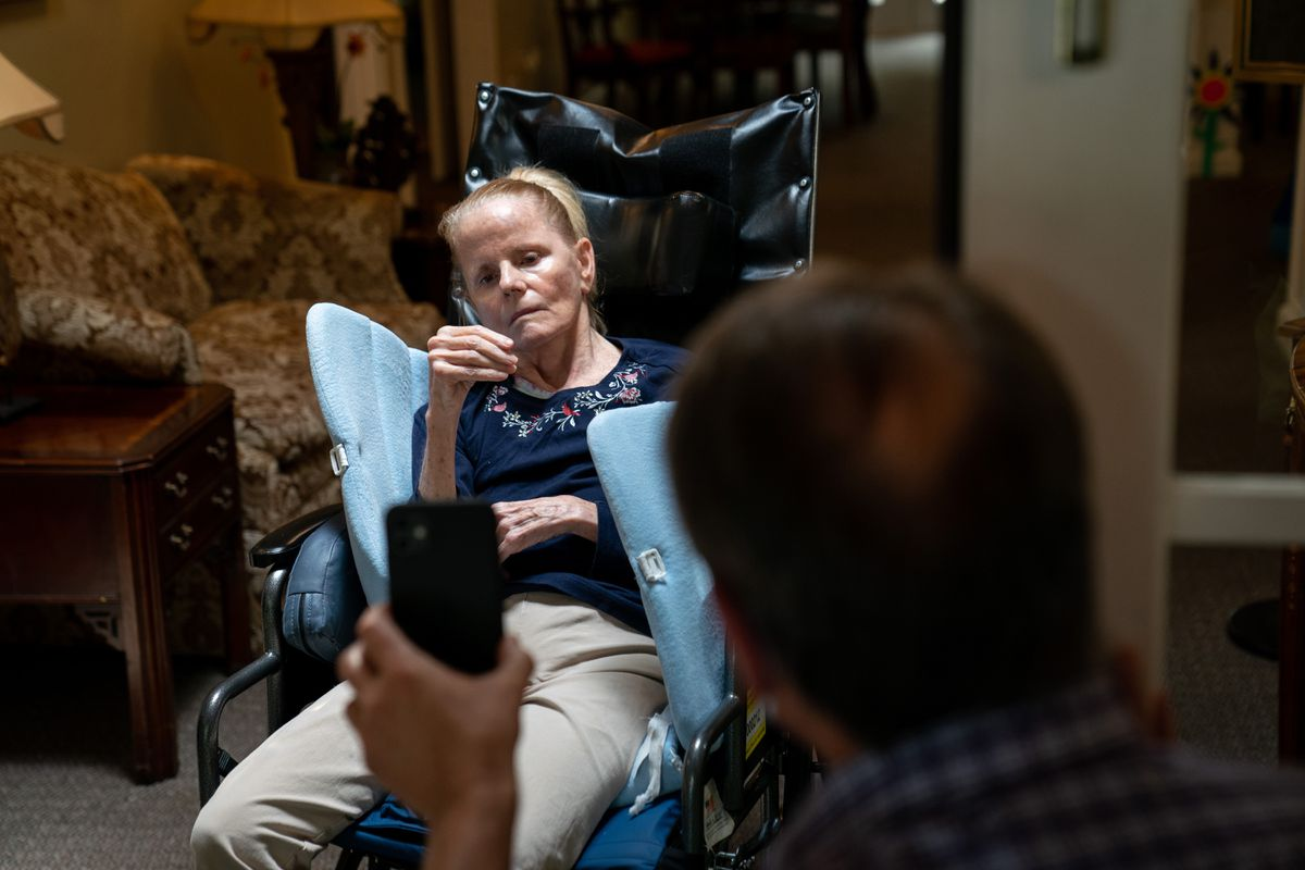 Dan Goerke, 61, visits his wife, Denise, at her assisted living facility in the Sandy Springs suburb of Atlanta on Aug. 5, 2020. Denise was diagnosed with Alzheimer's disease in 2012. (Photo for The Washington Post by Kevin D. Liles)