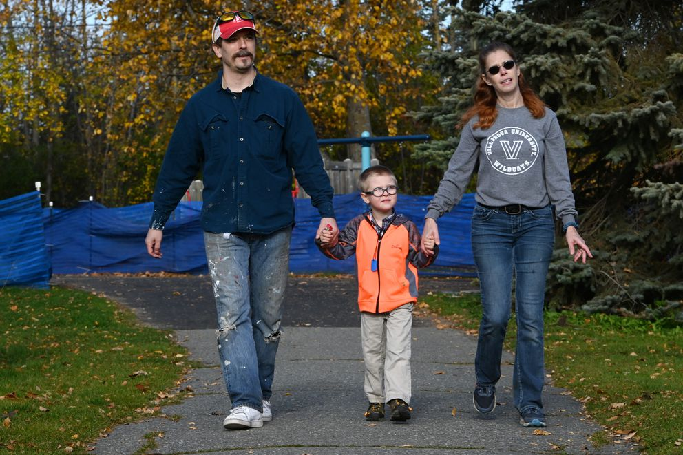 Thomas and Danna Hoellering walk with their six-year-old grandson Daniel after a visit to a neighborhood park on Sunday, Oct. 11, 2020. (Bill Roth / ADN)