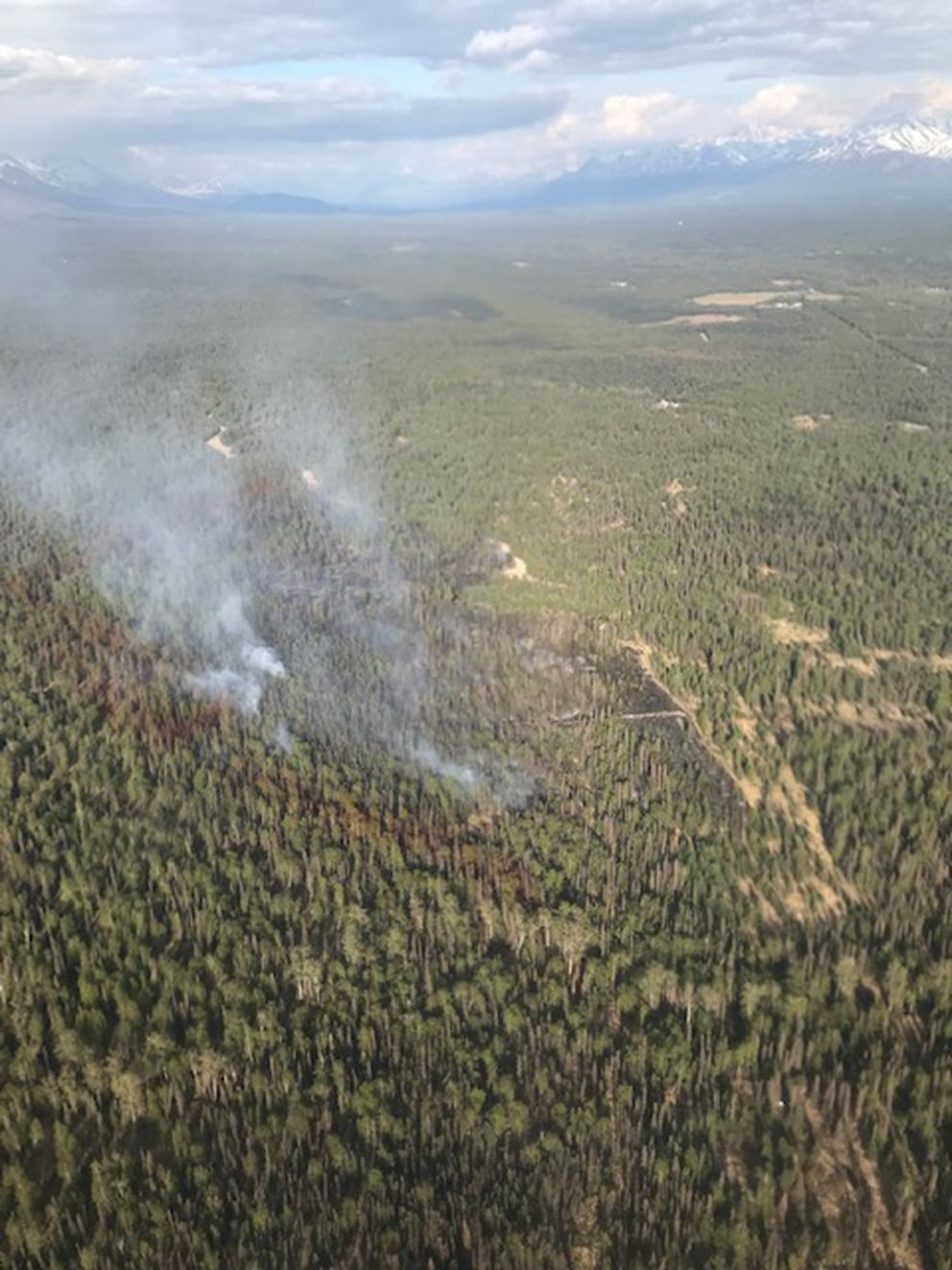 An aerial photo taken at 7 p.m. by Division of Forestry air attack personnel shows a significant reduction in smoke being produced by the Moose Meadows Fire as a result of aerial and ground suppression efforts. (Photo by Duane Morris/Alaska Division of Forestry.)