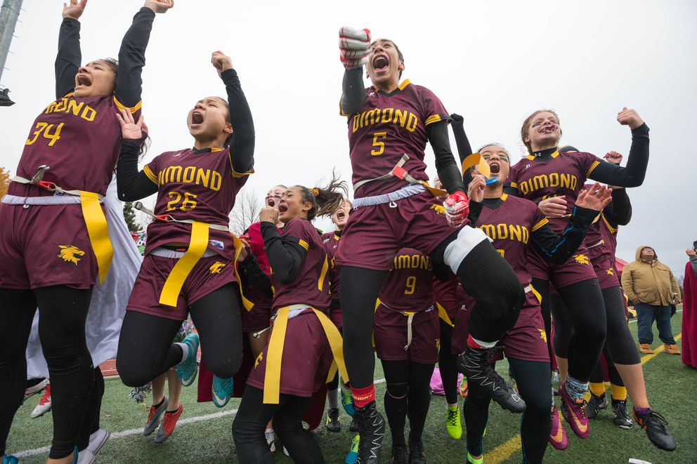 The Dimond High flag football team celebrates a fourth-quarter game-winning touchdown during the state flag football championship against West Saturday, Oct. 13, 2018 at Dimond. Dimond won for the second year in a row, and West was runner-up for the third year in a row. (Loren Holmes / ADN)