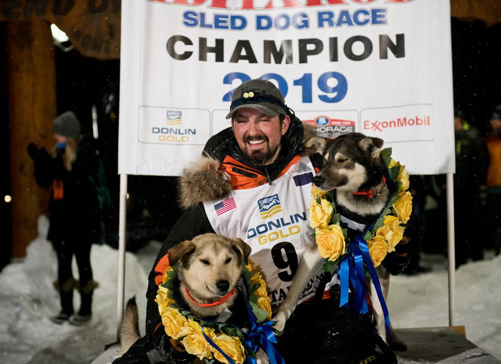 Peter Kaiser poses with his lead dogs, Morrow, left, and Lucy. Kaiser of Bethel reached Nome to win the 2019 Iditarod Sled Dog Race on March 13, 2019. (Marc Lester / ADN)