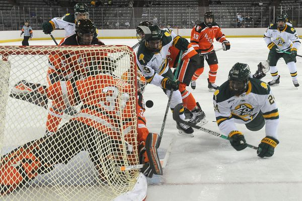 Bowling Green goalie Eric Dop stops the hockey puck as Trey deGraaf and Malcolm Hayes try to score at Sullivan Arena in Anchorage, AK on Friday, Nov. 9, 2018. (Bob Hallinen / ADN)