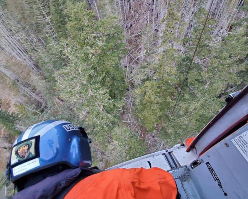 View from the Coast Guard helicopter Feb. 22, 2020, as a basket was lowered to retrieve Joseph Oldenbush on Washington's Olympic Peninsula. (U.S. Coast Guard photo)