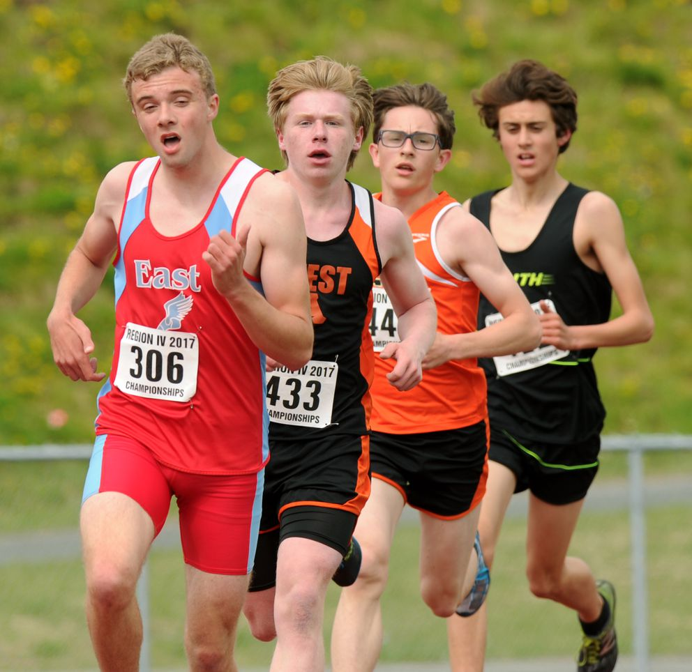 Zephan Ozturgut of East paces the field, including Daniel Bausch of West, Ethan Davis of West and Santiago Prosser of South, late in the boys 3,200. (Erik Hill / Alaska Dispatch News)