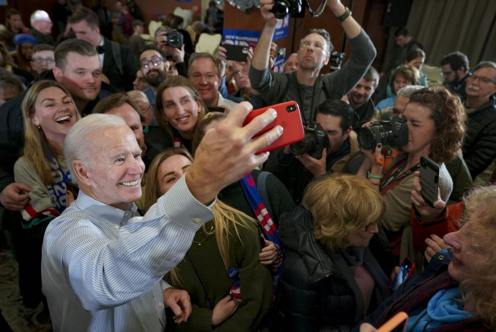 Joe Biden takes selfies with supporters in Hampton, New Hampshire, on Sunday, Feb. 9, 2020. Washington Post photo by Bonnie Jo Mount