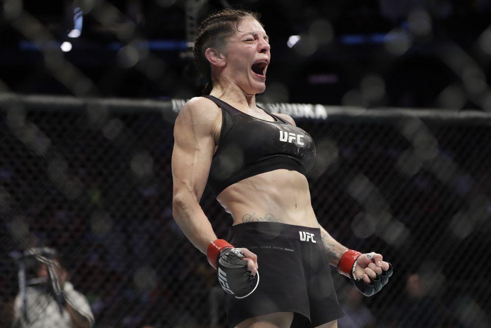 Lauren Murphy celebrates a UFC flyweight win over Italy's Mara Romero Borella in August 2019. (AP Photo/Frank Franklin II)