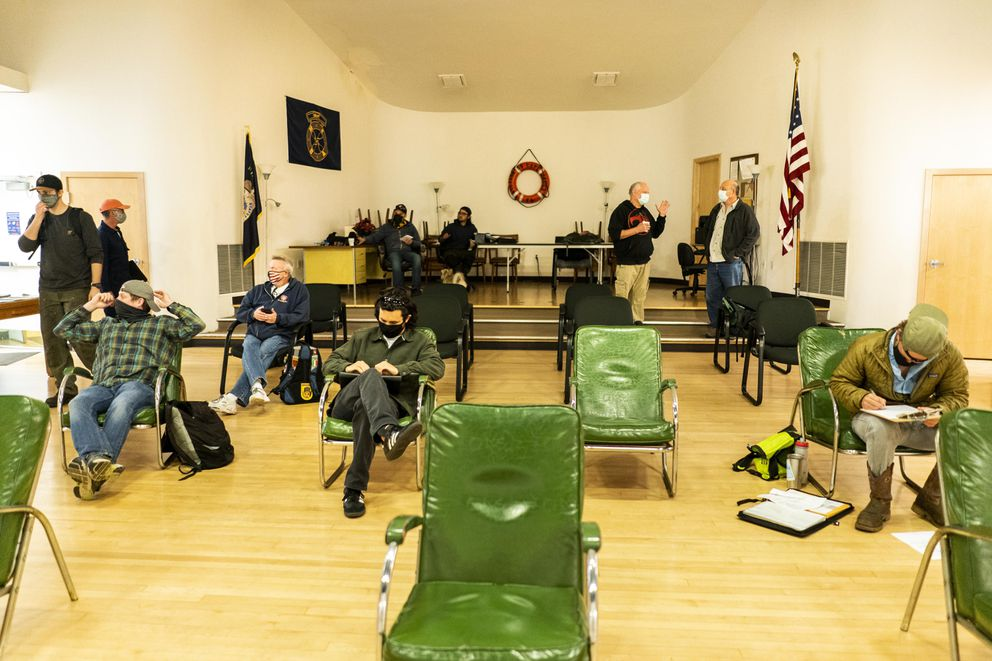 Merchant mariners, including engineers, wait to try for ship jobs at the International Organization of Masters, Mates & Pilots hiring hall in Oakland, Calif., on March 24. (Washington Post photo by Melina Mara)