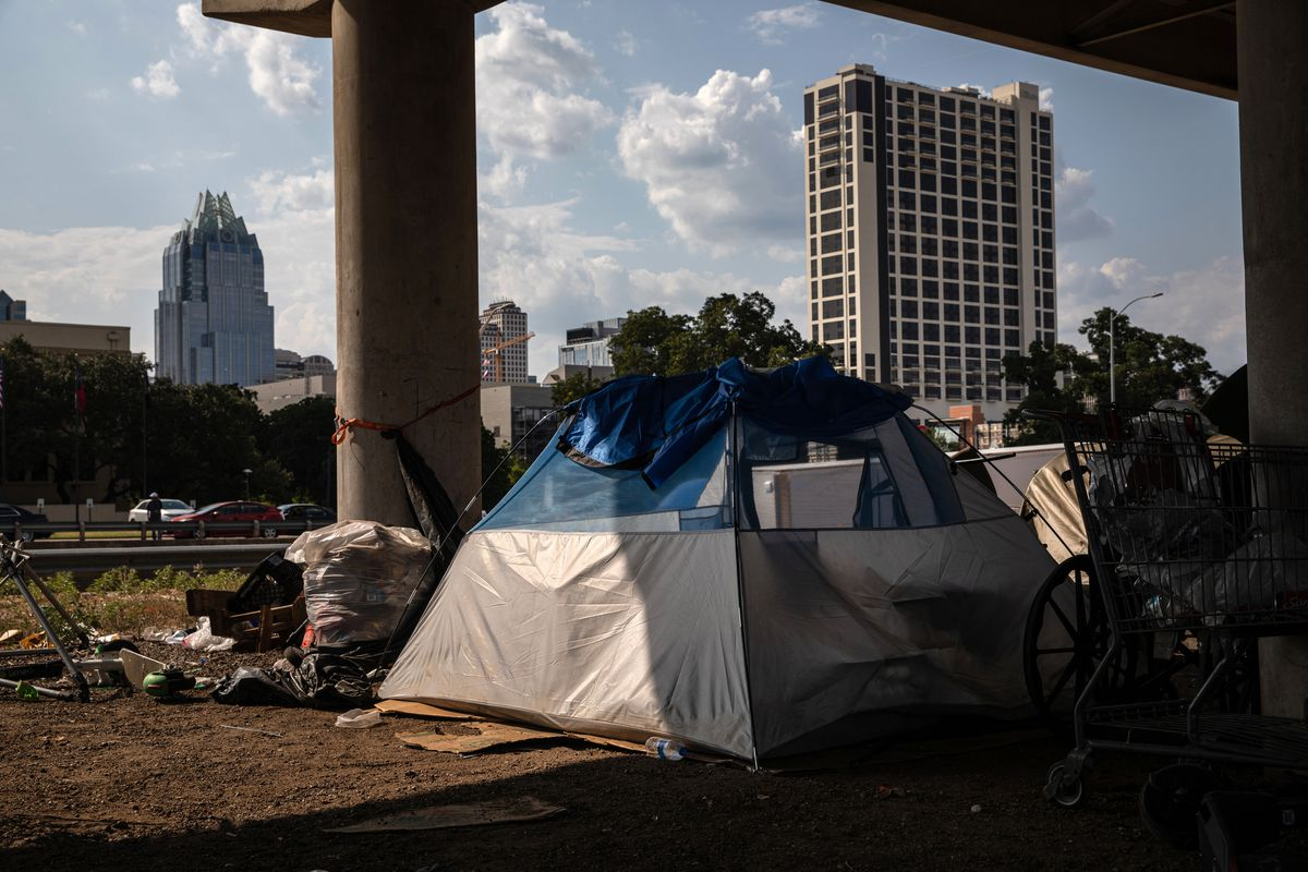 A tent encampment under Interstate 35 near downtown Austin on Aug. 14. Photo by Tamir Kalifa for The Washington Post.
