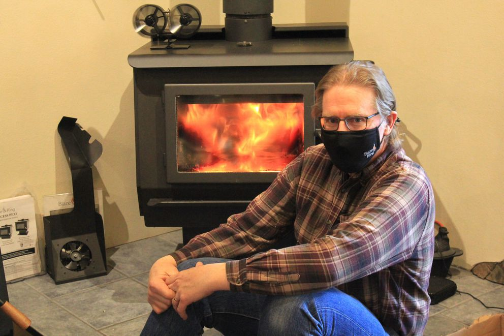 """Chris Neufeld, vice president of Blaze King: """"I would say that all these stoves – everything that our industry is currently (making) – is exceptionally clean-burning."""" (Liz Ruskin/Alaska Public Media)"""