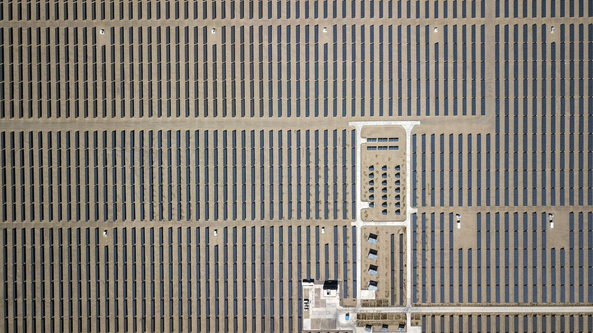 Photovoltaic panels stand at a solar power station operated by Huanghe Hydropower Development Co., a unit of State Power Investment Corp., at the Golmud Solar Park in this aerial photograph taken on the outskirts of Golmud, Qinghai province, China, on July 24, 2018. Qilai Shen/Bloomberg