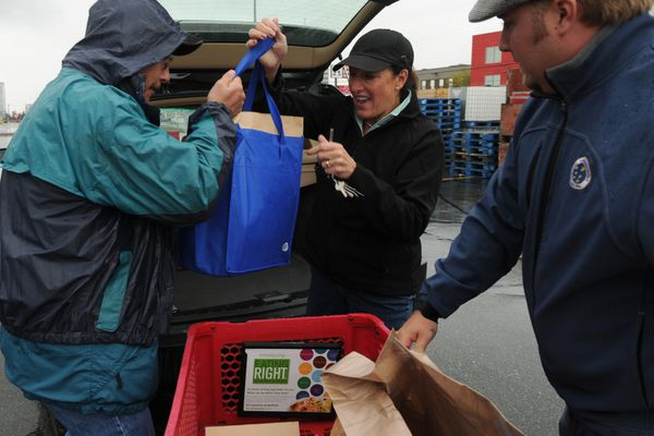 Volunteers from Clear Channel Media collect food donations during the United Way Day of Caring Food Drive in the parking lot of the Mall at Sears on Friday, September 14, 2012. 120914 (Bob Hallinen / Anchorage Daily News)