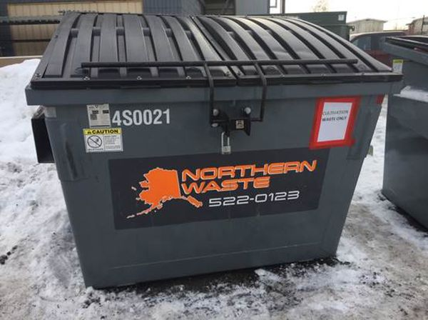 The dumpster behind AlaskaSense, an Anchorage commercial marijuana grow business. State and local inspectors recovered scraps of cannabis from around the dumpster in February 2018. (Photo provided by Alcohol and Marijuana Control Office)