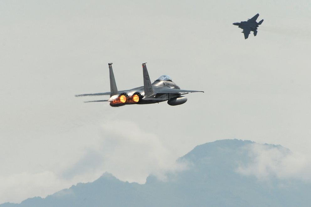 A pair of F-15C Eagles from the 18th Wing at Kadena Air Base, Japan, take off from Joint Base Elmendorf-Richardson June 23, 2015, during Northern Edge. (Bill Roth / ADN archive 2015)