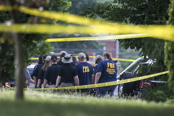 FBI Evidence Response Team members document the scene at Eugene Simpson Stadium Park following a shooting in Alexandria, Va., June 14, 2017. The shooting, at a baseball field where members of a congressional team regularly practice, left five injured, including House Majority Whip Steve Scalise (R-La.), police said. President Donald Trump said that the shooting suspect had died. (Al Drago/The New York Times)