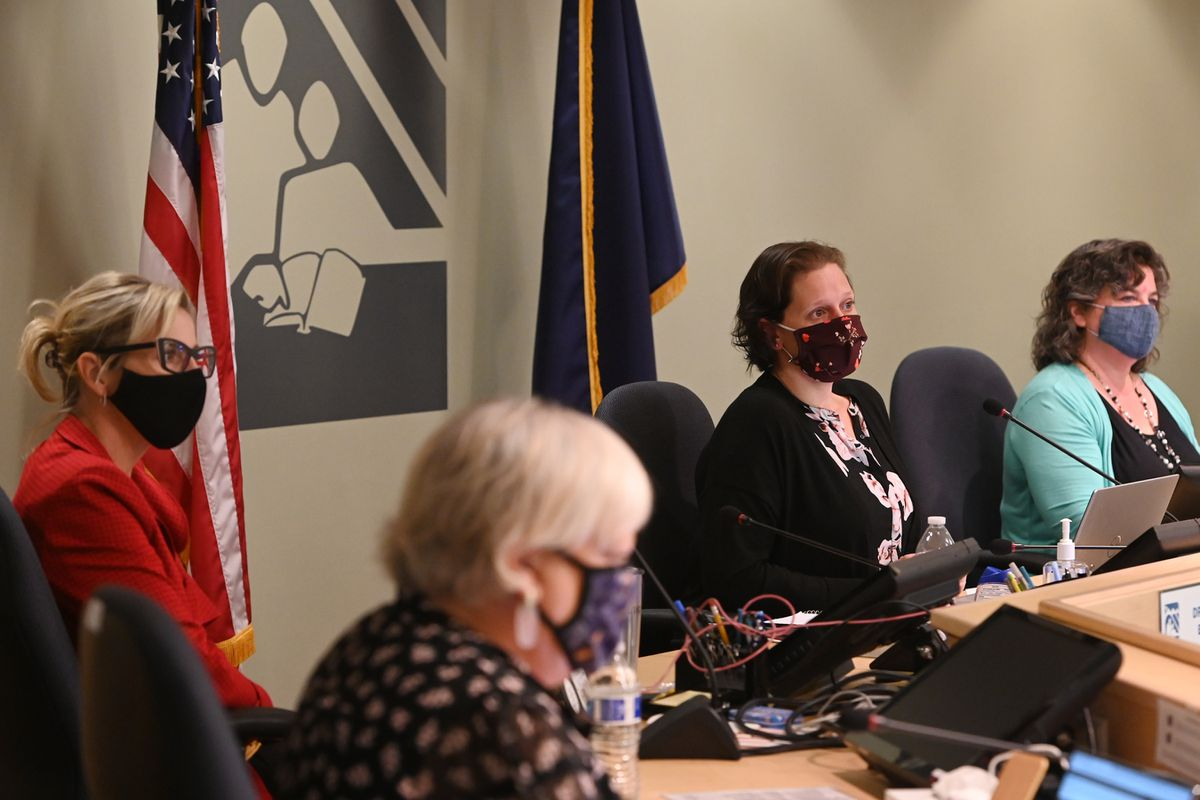 From left, Anchorage School District superintendent Dr. Deena Bishop, School Board member Starr Marsett, School Board president Elisa Vakalis, and executive assistant Katy Grant listen to public testimony during a School Board work session on Tuesday, July 21, 2020. (Bill Roth / ADN)