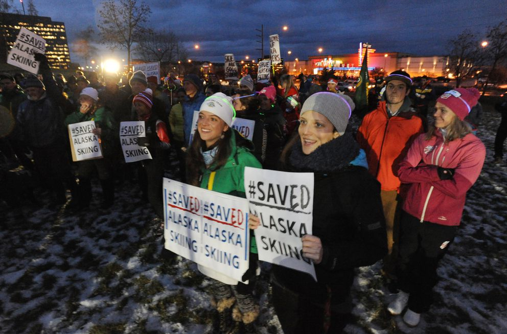 UAA ski team assistant coaches Sara Studebaker-Hall (nordic), left, and Anna Berecz (alpine), right, attend a rally for the skiing programs at UAA and UAF outside the Loussac Library in Midtown Anchorage Thursday. (Bill Roth / Alaska Dispatch News)