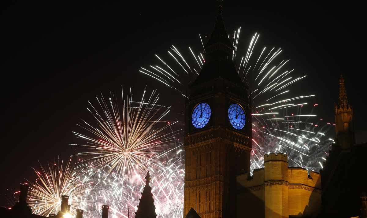 Fireworks explode over the River Thames and the Palace of Westminster's Elizabeth Tower, known as Big Ben, during the New Years Day celebrations in London, Friday, Jan. 1, 2016. (AP Photo/Alastair Grant)