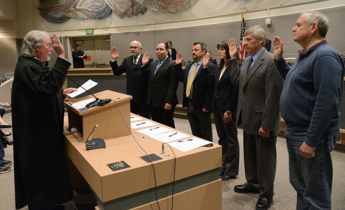 Alaska Supreme Court Chief Justice Craig Stowers swears in Anchorage Assembly members Fred Dyson, Felix Rivera, Christopher Constant, Suzanne LaFrance, Pete Peterson and Tim Steele at the Loussac Library on Tuesday. (Bob Hallinen / Alaska Dispatch News)