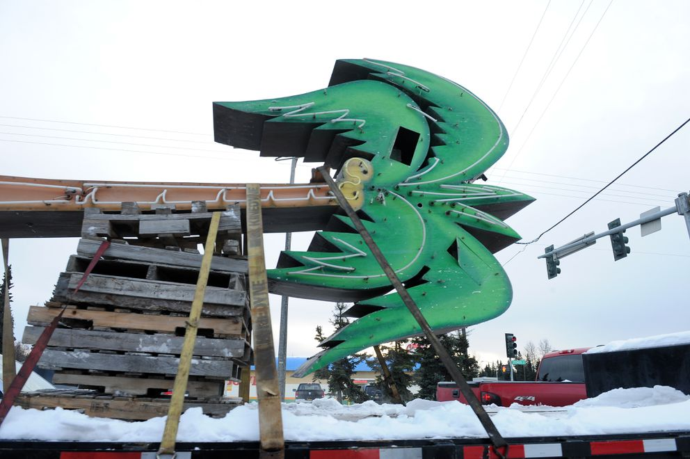 The palm tree is removed from the Paradise Inn in November. (Bob Hallinen / ADN archive)