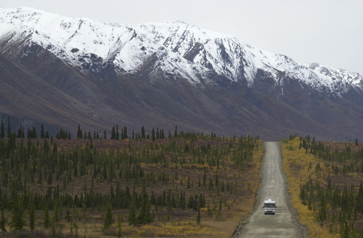 An RV meanders down a rough stretch of the western Denali Highway in September 2002. (Bradley J. Boner / ADN file photo)