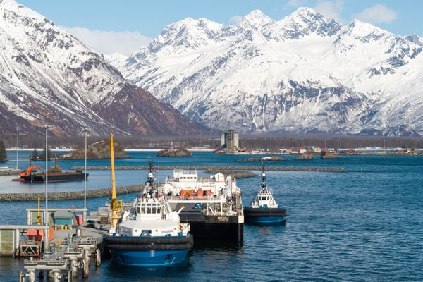 Three Edison Chouest Offshore vessels docked at the Ship Escort/Response Vessel System facility Monday, April 2, 2018 in Valdez. From left, escort tug Commander, ORSB-1 oil spill response barge, and the general purpose tug boat Elrington. (Loren Holmes / ADN)
