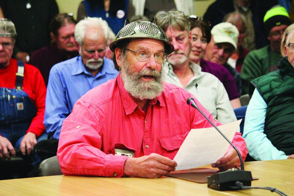 Fritz Creek area resident Barrett Fletcher gives the invocation before a Kenai Peninsula Borough Assembly meeting as a representative of the Church of the Flying Spaghetti Monster at Homer City Hall in Homer, Alaska, Tuesday, Sept. 18, 2019. (Megan Pacer/Homer News via AP)