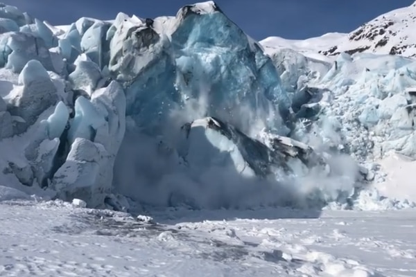 A mass of ice calves from Portage Glacier on Saturday morning, April 11, 2020. (Screengrab from Jason Rouch Jr. video posted on Facebook)