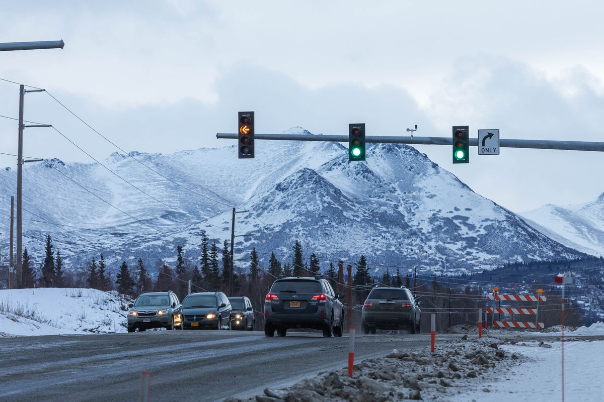 A flashing yellow light blinks at the O'Malley Road and Lake Otis Parkway intersection on Wednesday, Jan. 17, 2018. (Loren Holmes / ADN)
