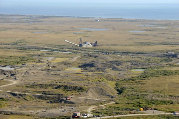 A gold dredge sits on the tundra near Nome, AK on Monday, August 22, 2016. (Bob Hallinen / ADN)