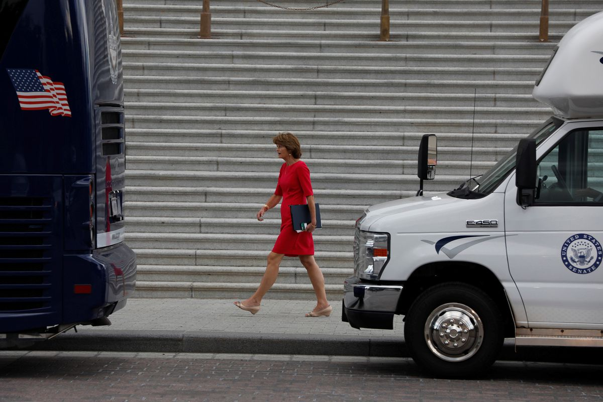 Sen. Lisa Murkowski, R-Alaska, walks to board a bus to the White House to discuss the upcoming Senate health care bill with President Donald Trump in Washington, D.C., onJune 27. (Aaron P. Bernstein / Reuters)