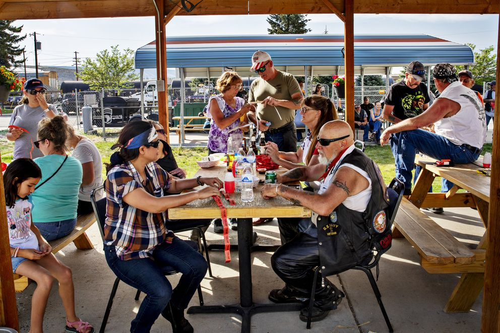 People gather at the American Legion Post in Rock Springs, Wyo., on June 12. Rock Springs is in Sweetwater County, where the coronavirus caseload remains high and few residents are vaccinated. MUST CREDIT: Photo by Kim Raff for The Washington Post.