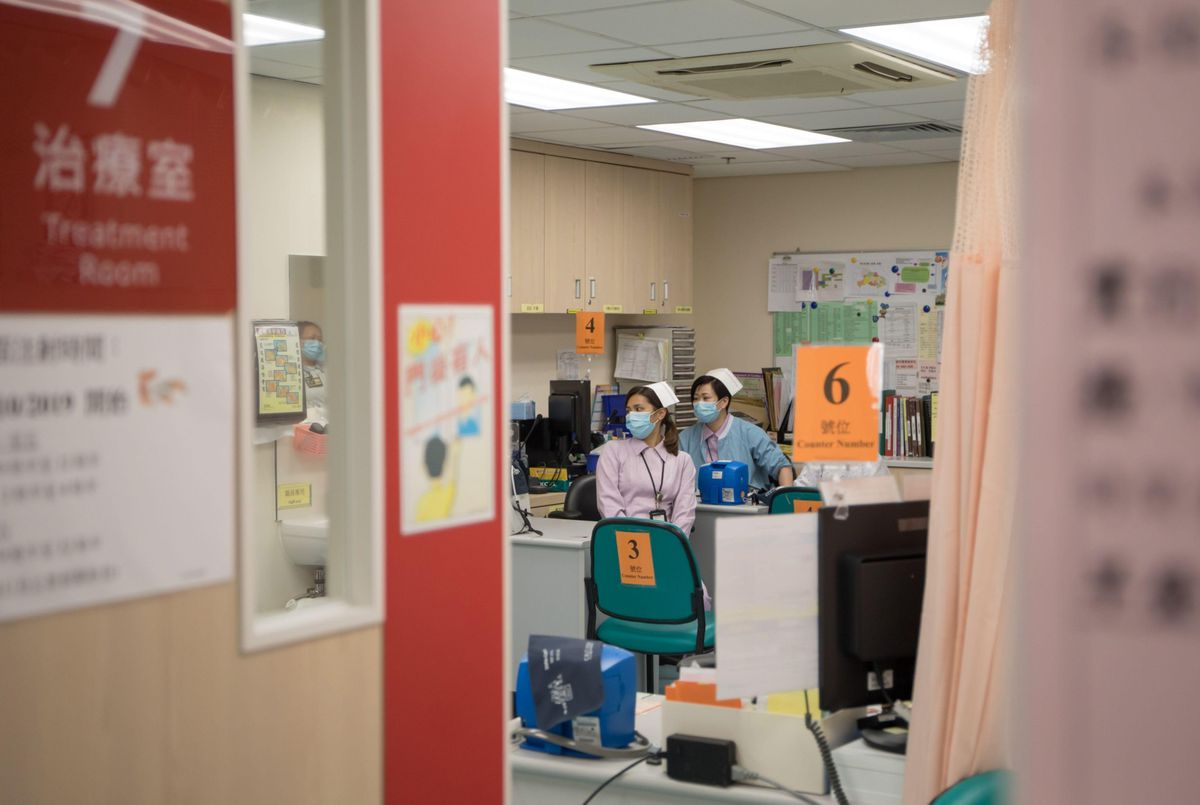 Nurses work during a media tour at a designated treatment clinic for the Wuhan coronavirus in the Kowloon Bay district of Hong Kong on Jan. 23, 2020. (Bloomberg photo by Paul Yeung)