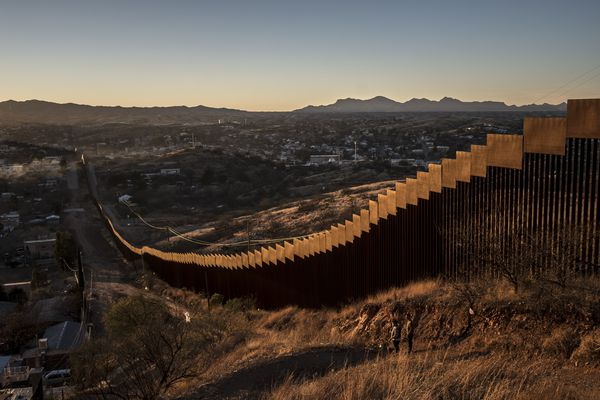 "FILE-- The border wall, here made of tall steel beams in rows, in Nogales. Mexico, Jan. 30, 2017. Trump at a campaign-style rally in Phoenix on Aug. 22 promised he would shut down the government if Congress does not fund a wall on the southern border. Tuesday's admonition sharpened a suggestion that Trump made early this year, in the wake of a budget agreement he grudgingly accepted even though it omitted money for the wall, that the U.S. needed ""a good 'shutdown'"" this fall to force a partisan confrontation over federal spending. (Bryan Denton/The New York Times)"