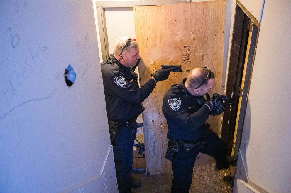 Senior Patrol Officers Eric Nowak, left, and Brian Fuchs respond to a trespass call Wednesday, April 3, 2019 in Mountain View. A private security guard had observed two people inside a boarded-up apartment, but by the time the officers arrived the unit was empty. (Loren Holmes / ADN)