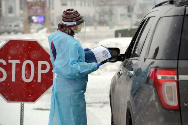 Colleen Murphy, a Providence nurse, does pre-screening at a drive-thru COVID-19 testing site on Lake Otis Blvd., Monday, March 17, 2020. (Anne Raup / ADN)